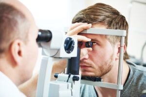 patient under eye vision examination in eyesight ophthalmological correction clinic