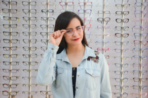 Beautiful girl in glasses on a background.