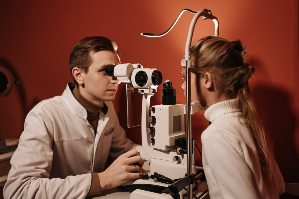 doctor examining Kid's eyes with a measurement machine.