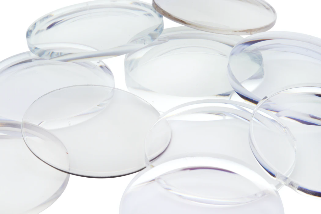clear glass round ornament on white surface